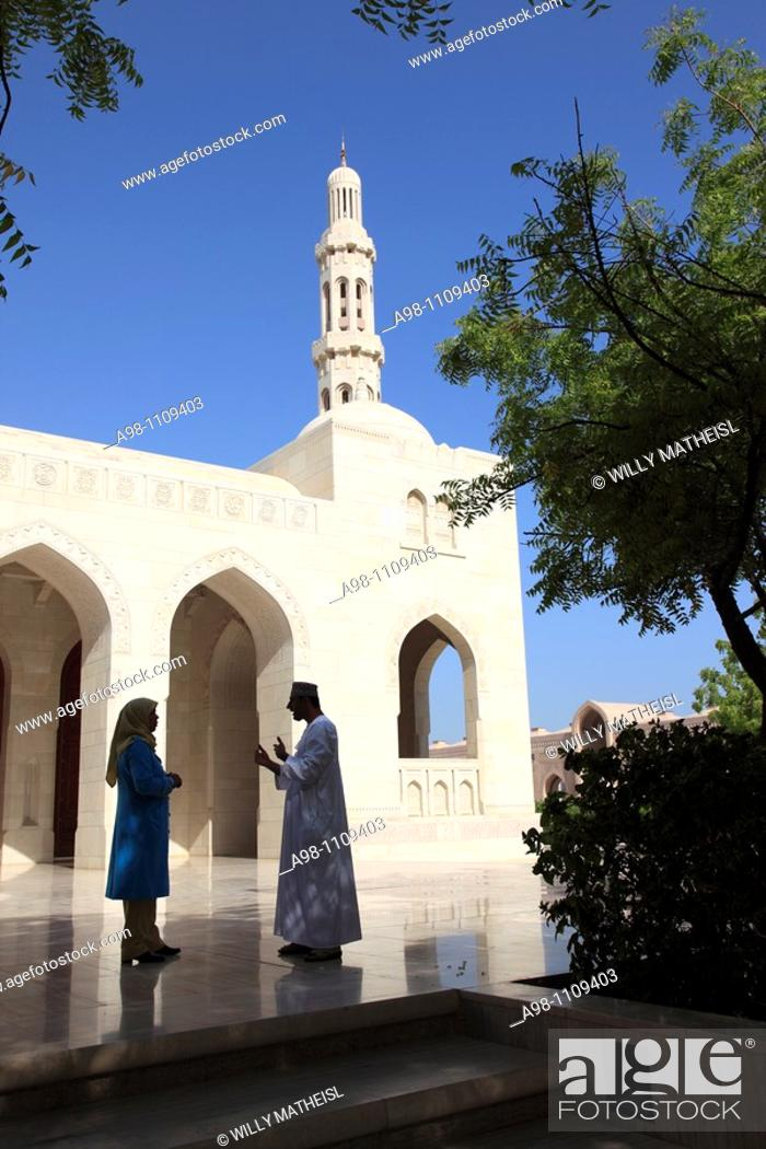 Stock Photo: Omani man and woman talking outside in front of Grand Mosque Sultan Qaboos, Muscat, Sultanat of Oman, Asia.