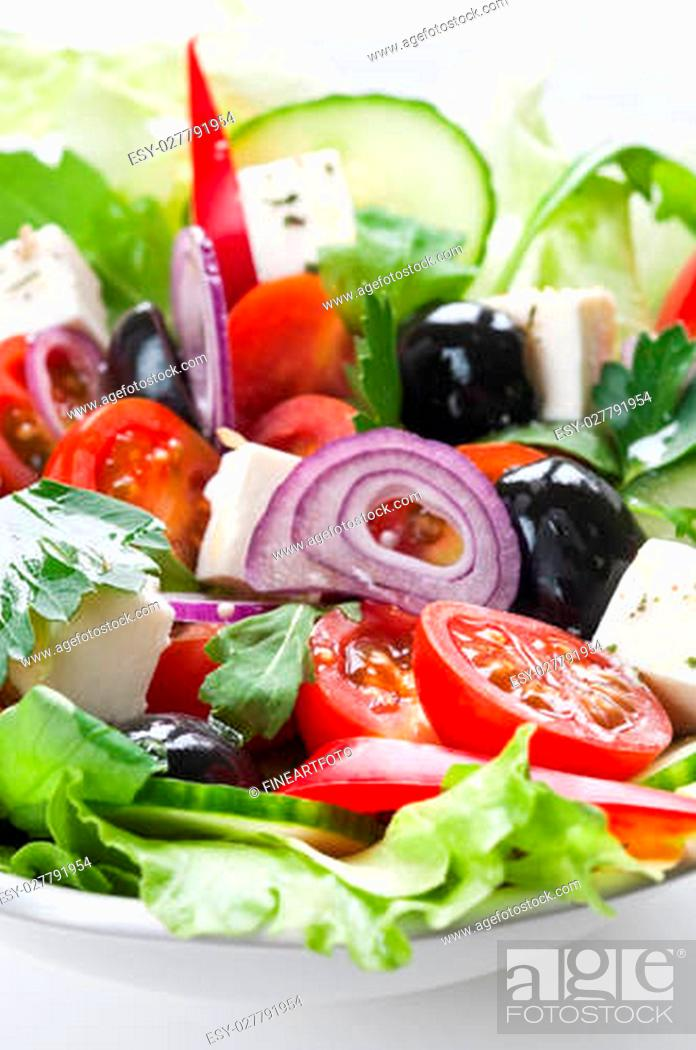 Stock Photo: Greek salad with feta, cherry tomatos and black olives.