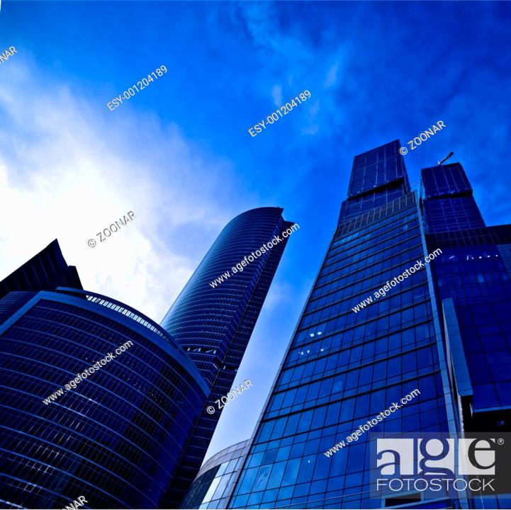 Stock Photo: Modern skyscrapers business centre at evening light.