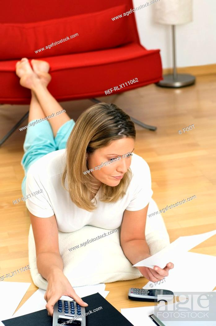 Stock Photo: Woman doing home finances.