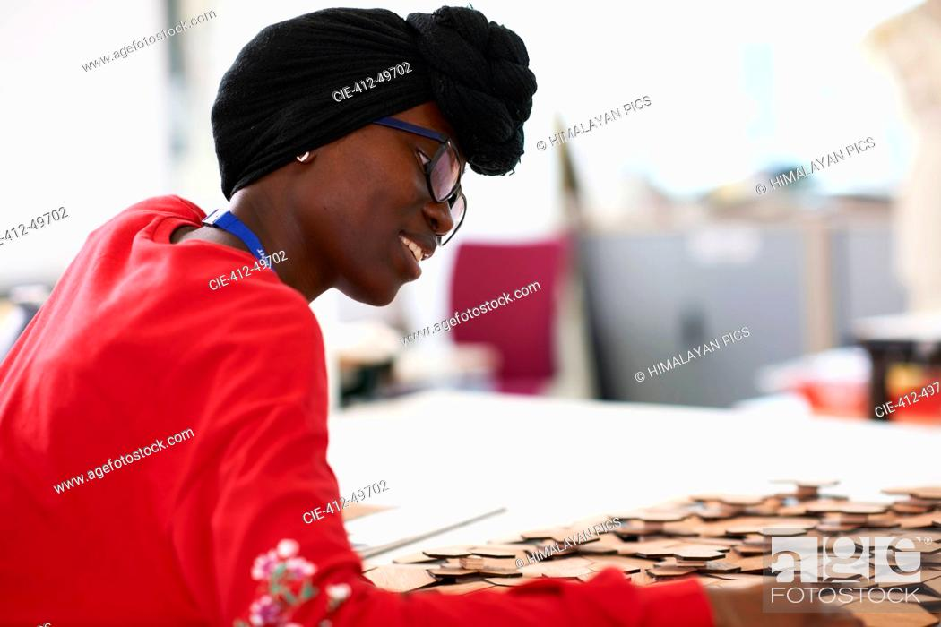 Stock Photo: Young female artist wearing dhuku in art studio.