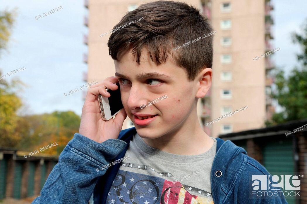 Stock Photo: Teenage boy talking on mobile phone.