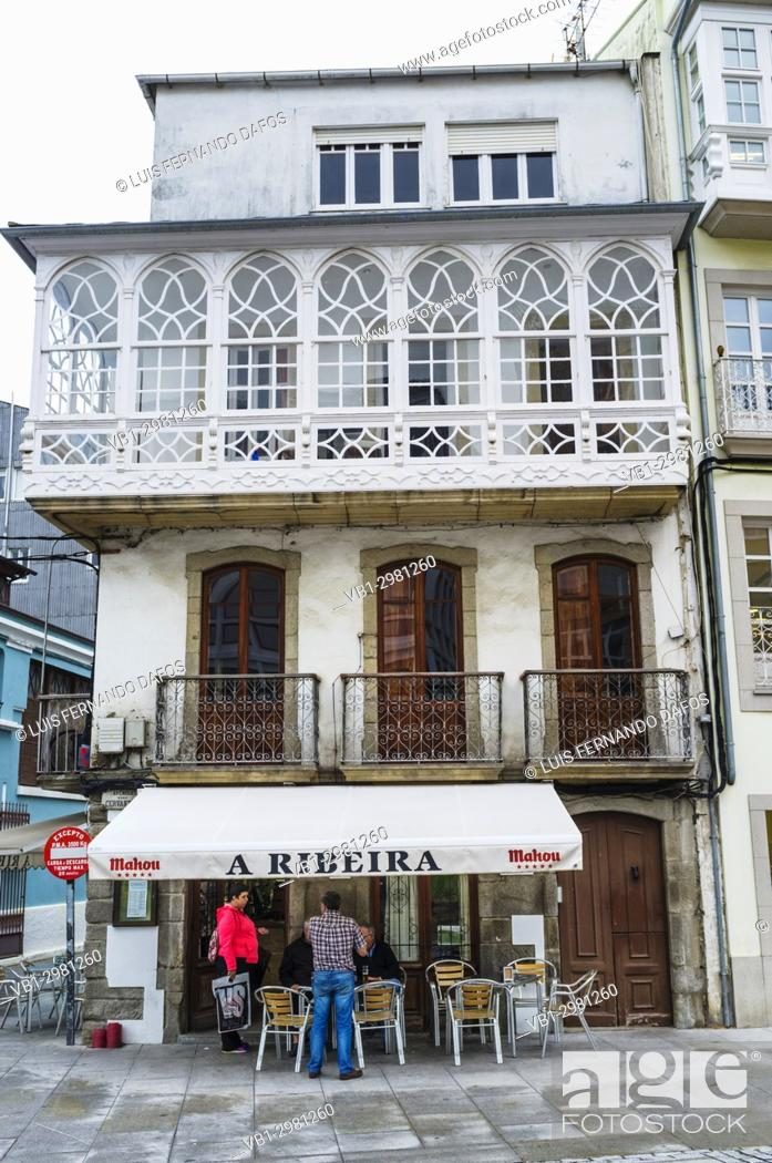 Stock Photo: Bar at a traditional Galician architecture building with glass gallery at Viveiro, Lugo Province, Galicia, Spain, Europe.