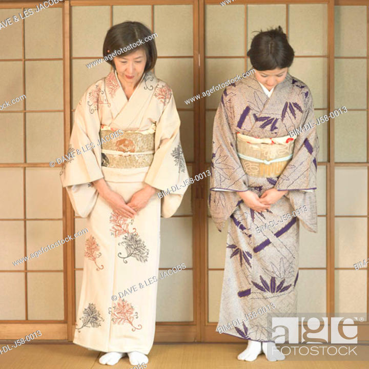 Stock Photo: Two Asian women bowing.