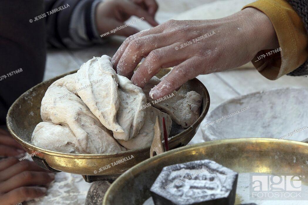 Stock Photo: Baker kneading bread.