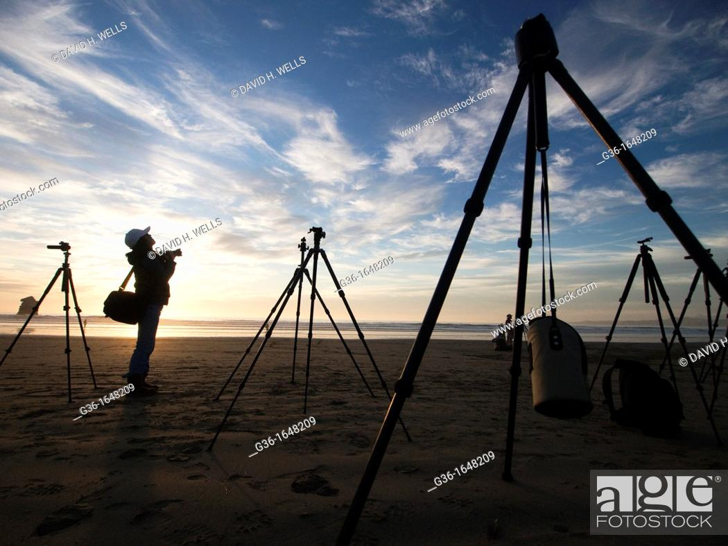 Stock Photo: Photography equipment on the beach at sunset in Morro Bay, California, United States.