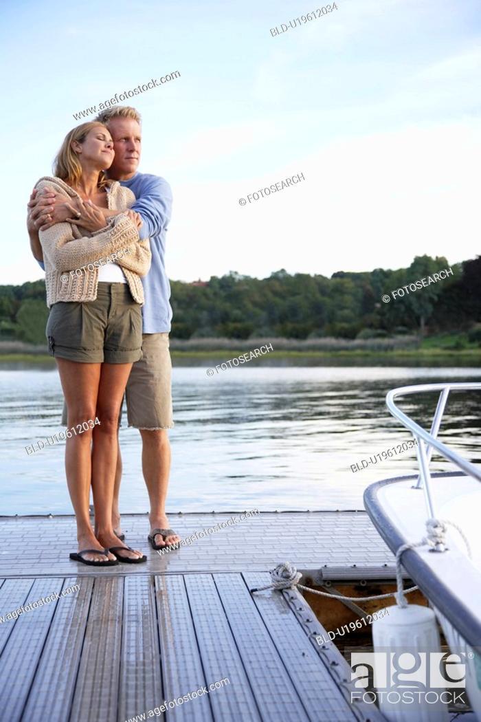Stock Photo: Couple hugging on pier.
