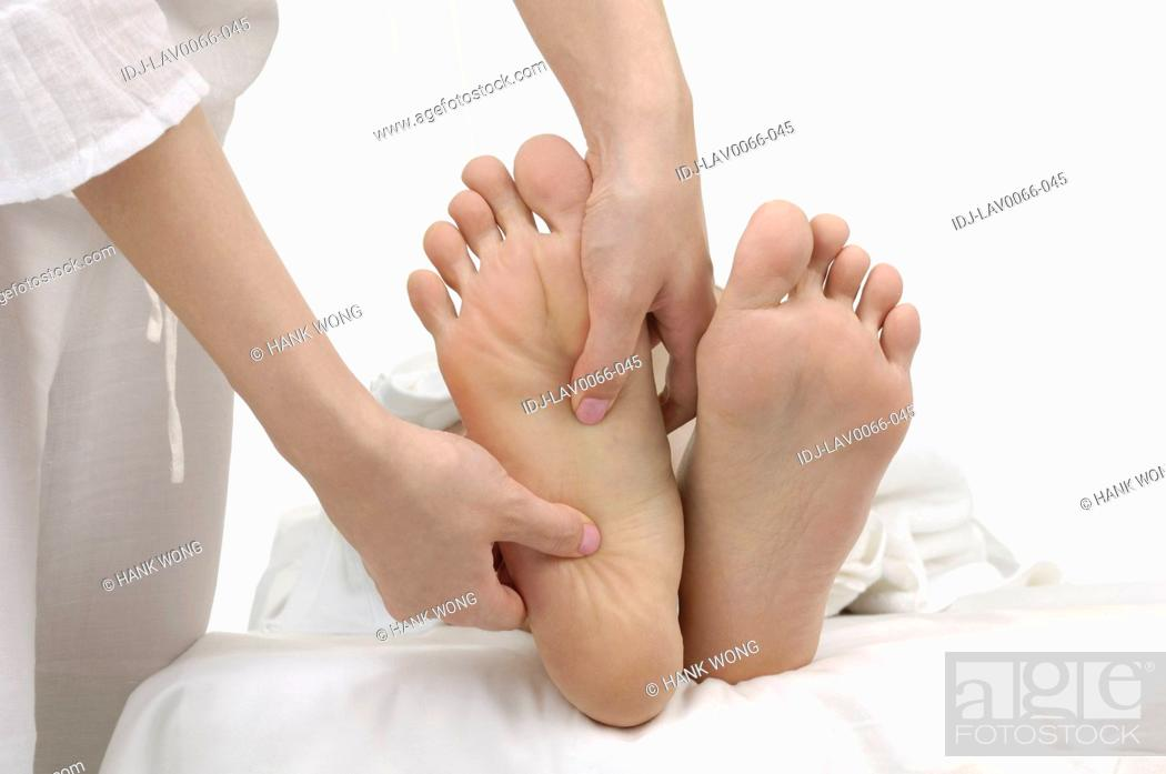 Stock Photo: Close-up of a woman getting leg massage.