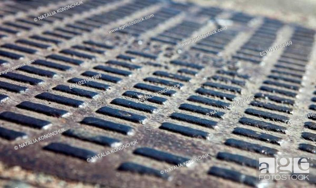 Stock Photo: Close up of the metal manhole cover.