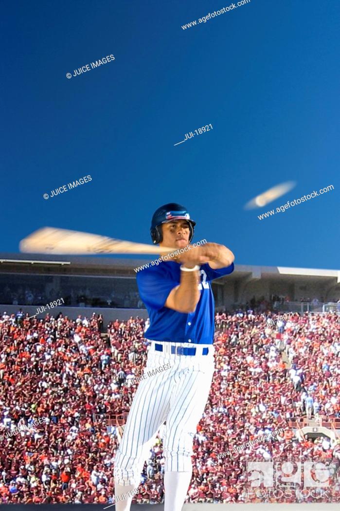 Stock Photo: Batter swinging at baseball.