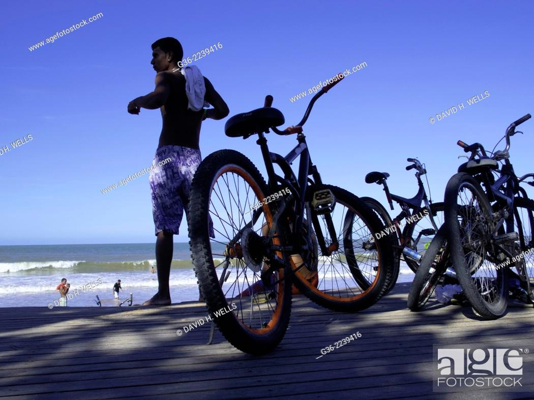 Stock Photo: Man with bicycles at beach, Vitoria, Espirito Santo, Vitoria.