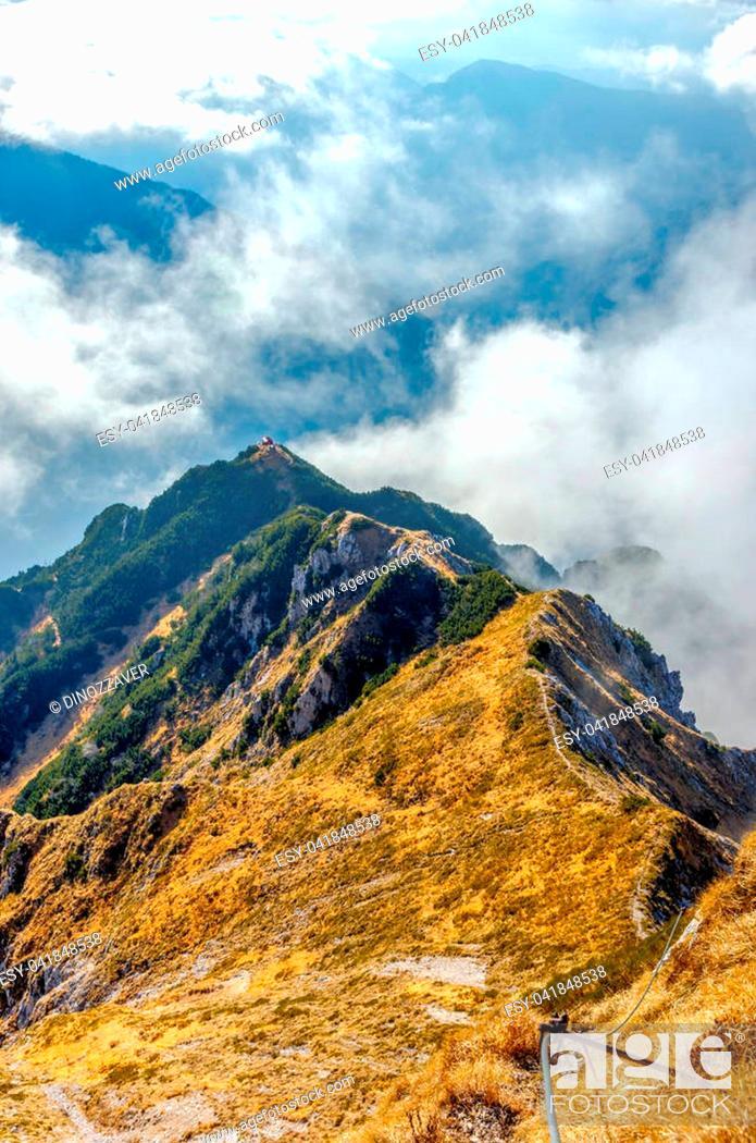 Stock Photo: Via ferrata over the sea of clouds to bivouac Dino above Udine. The Alps, Italy.