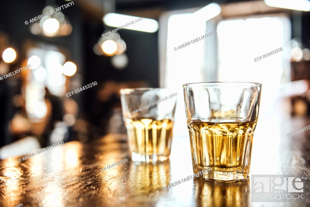 Stock Photo: glasses of whiskey on the table in the barbershop.