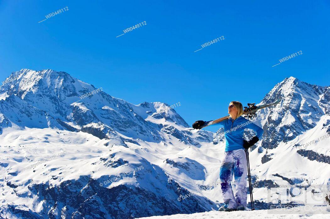Stock Photo: A skier enjoying the snowy winter mountains.