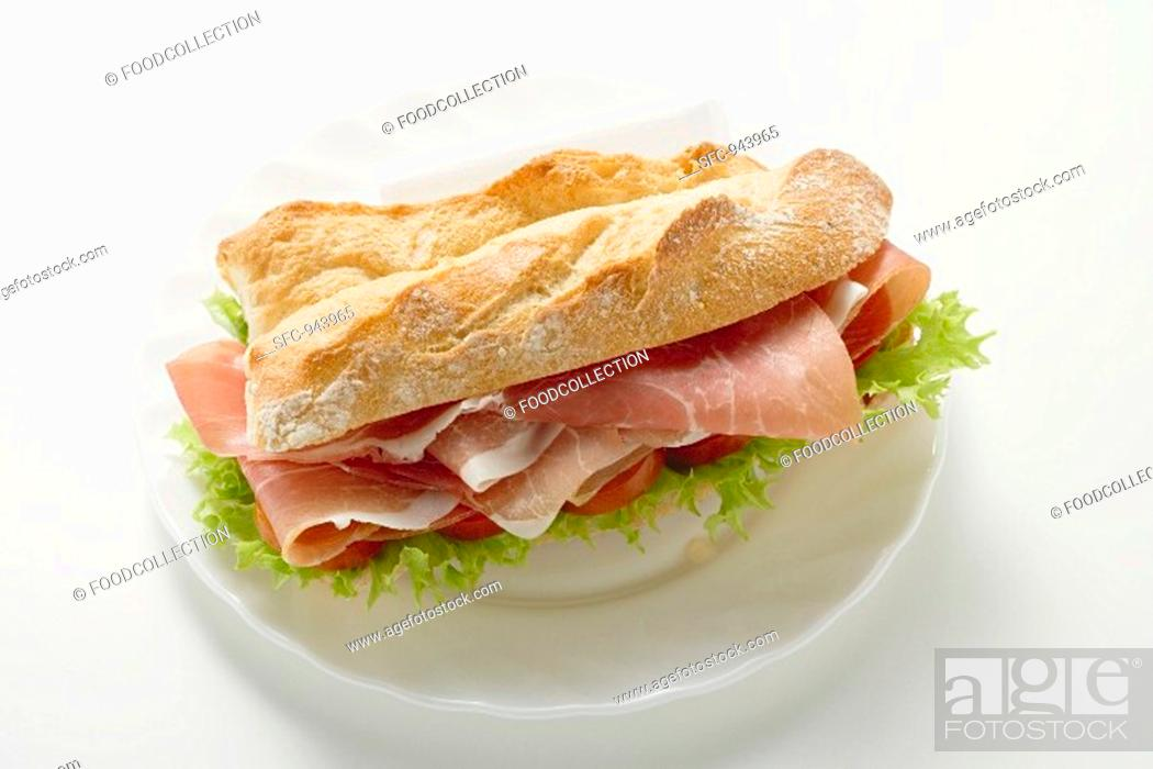 Stock Photo: Sub sandwich with raw ham on a plate.