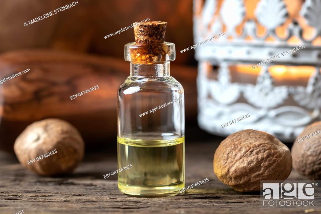 Stock Photo: A bottle of nutmeg essential oil.