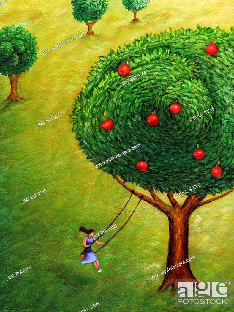 Stock Photo: A woman on a tree swing and an apple tree.