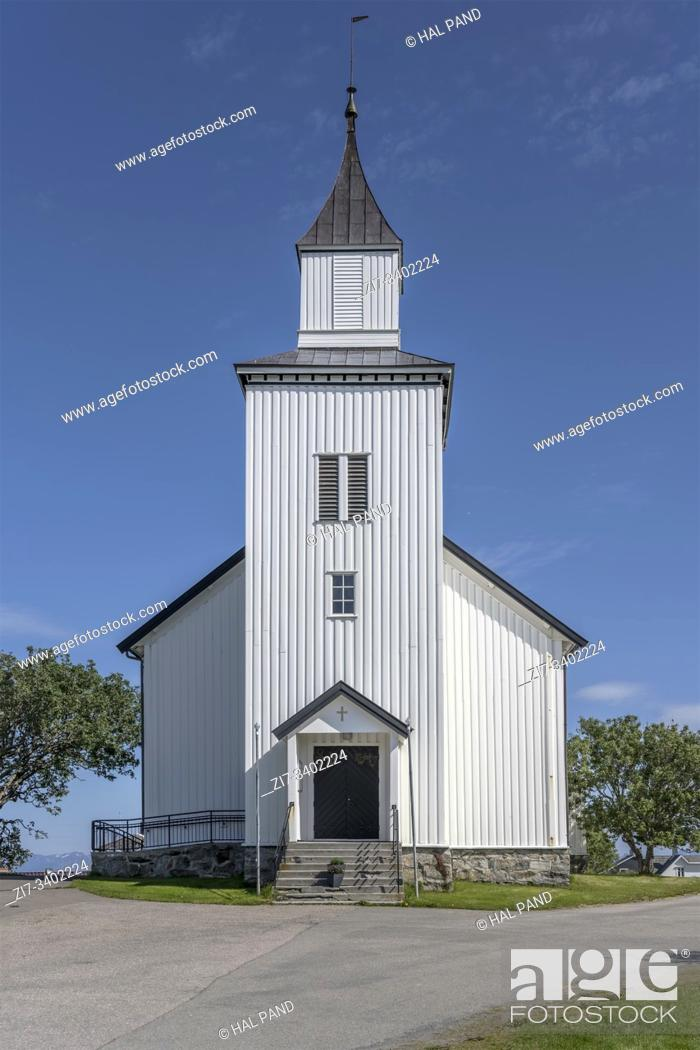 Stock Photo: cityscape with white traditional facade of church at artic touristic village , shot under bright summer light at Andenes, Andoya, Vesteralen, Norway.