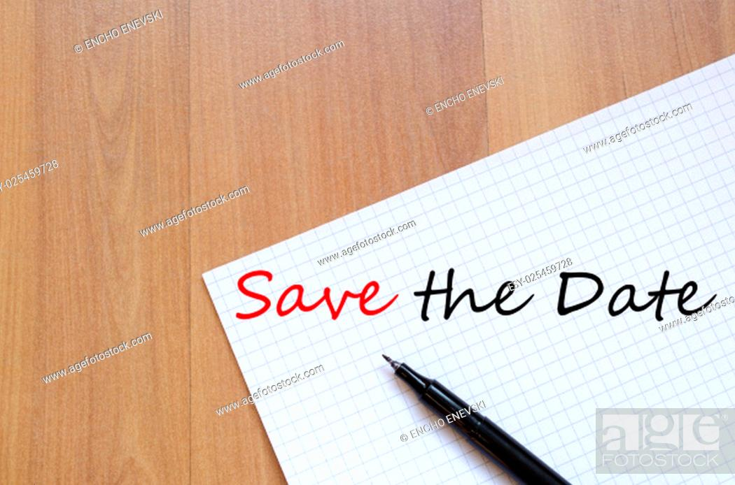 Stock Photo: White blank notepad on office wooden table Save the date concept.