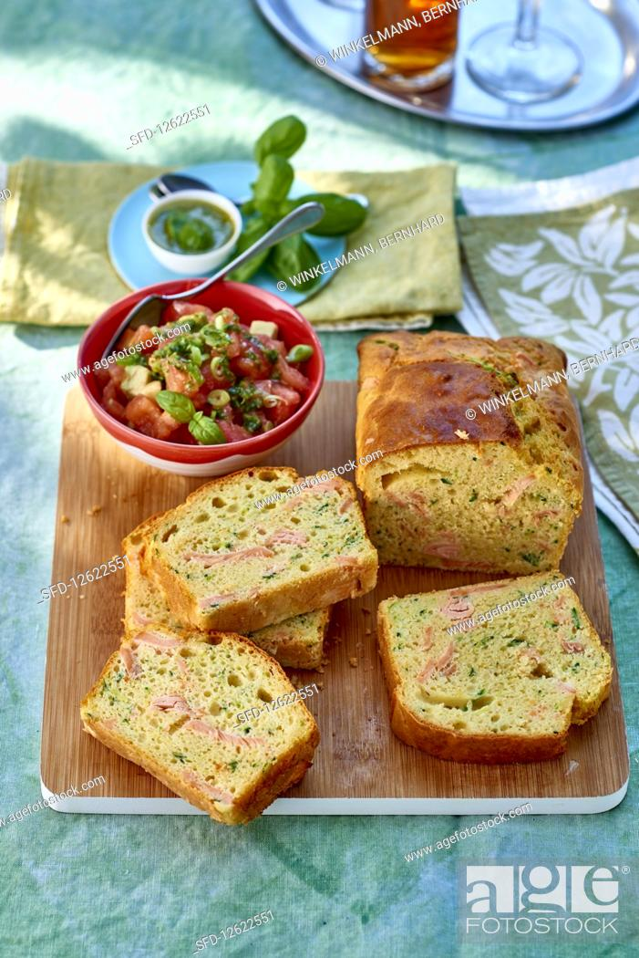 Stock Photo: Spicy cake with salmon, courgette and Parmesan with tomato tartare.