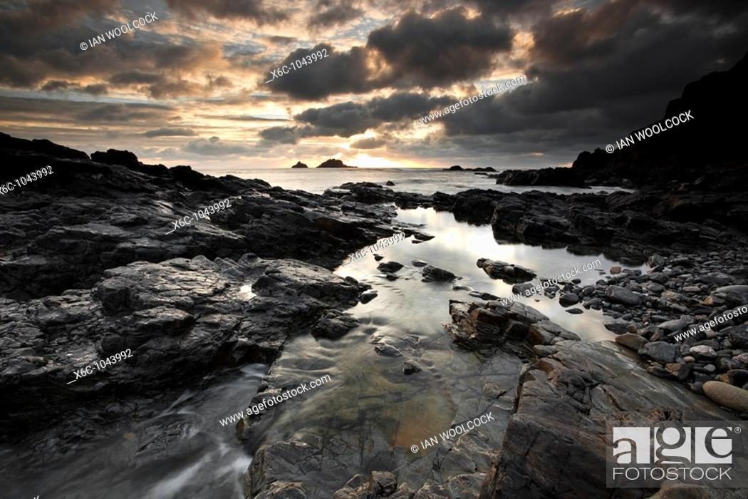Stock Photo: Dramatic Sunset at Priests Cove, Cape Cornwall England UK.