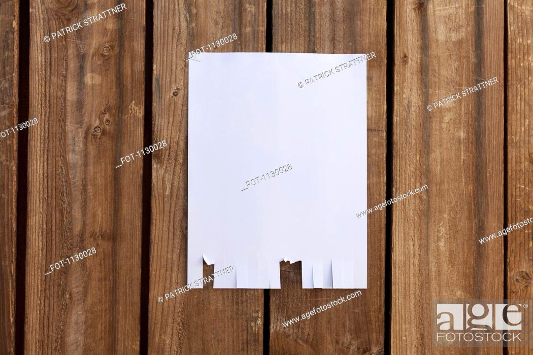 Stock Photo: A blank flyer hanging on a wooden fence.