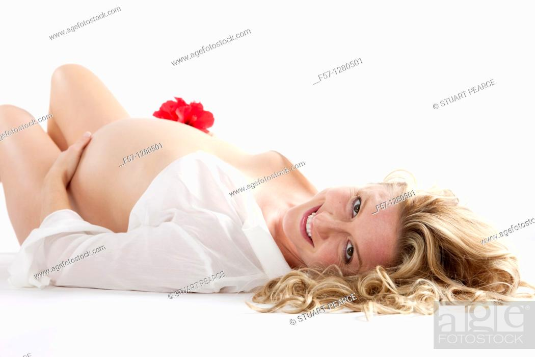 Stock Photo: Nine months pregnant mother to be.