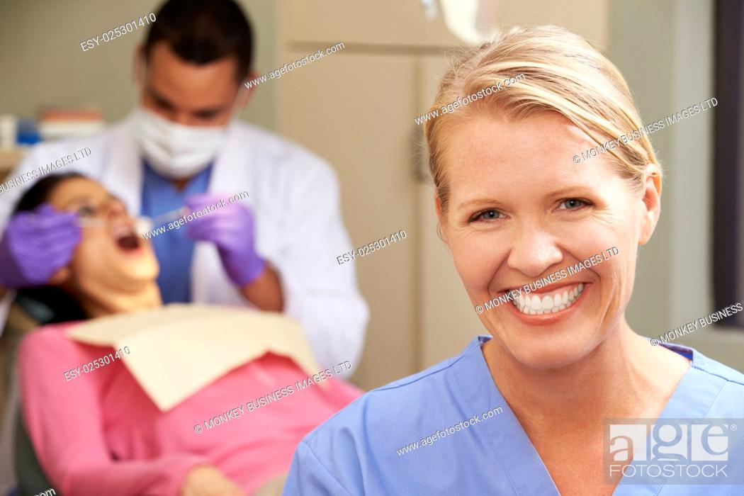 Stock Photo: Portrait Of Dentist And Dental Nurse In Surgery.
