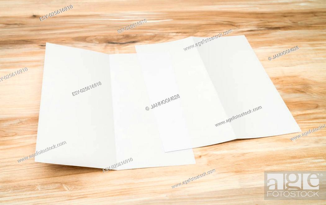 Stock Photo: Bifold white template paper on wood texture.