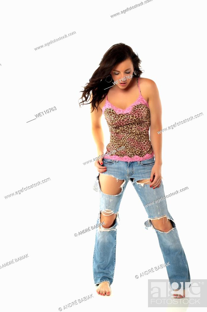 Stock Photo: Sexy woman in ripped jeans and teenager outfit.