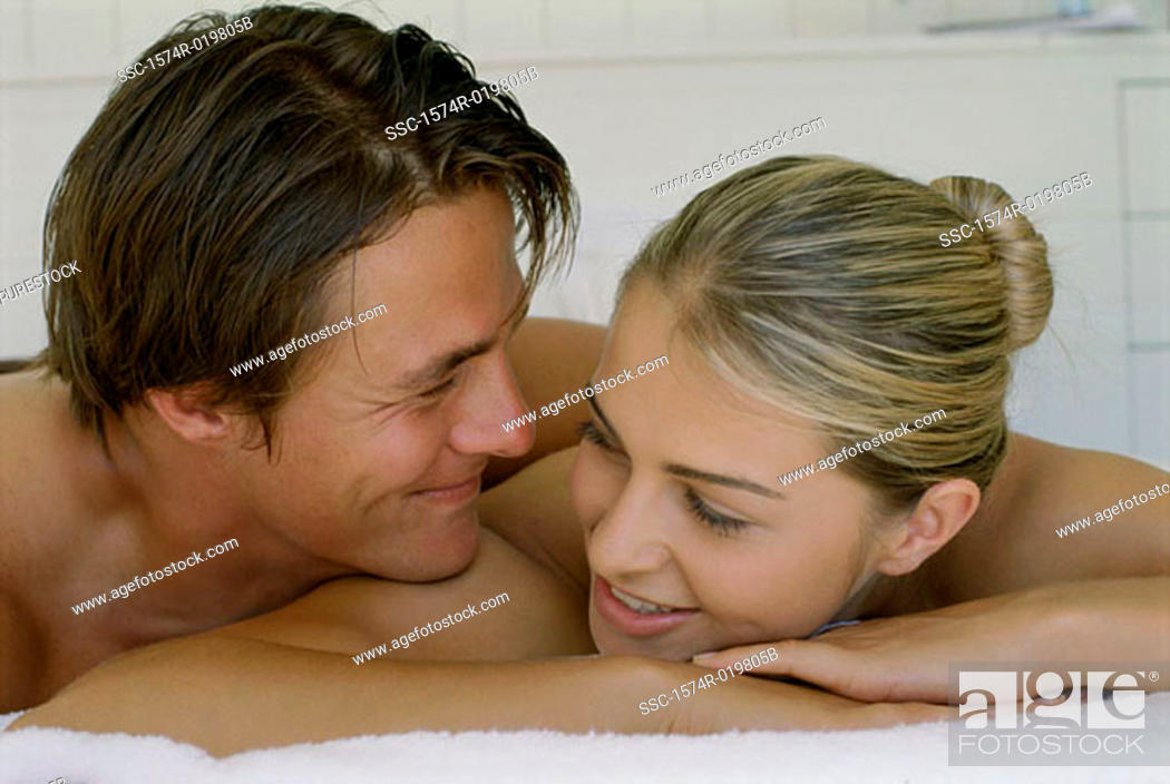 Stock Photo: Close-up of a young couple lying on the bed.