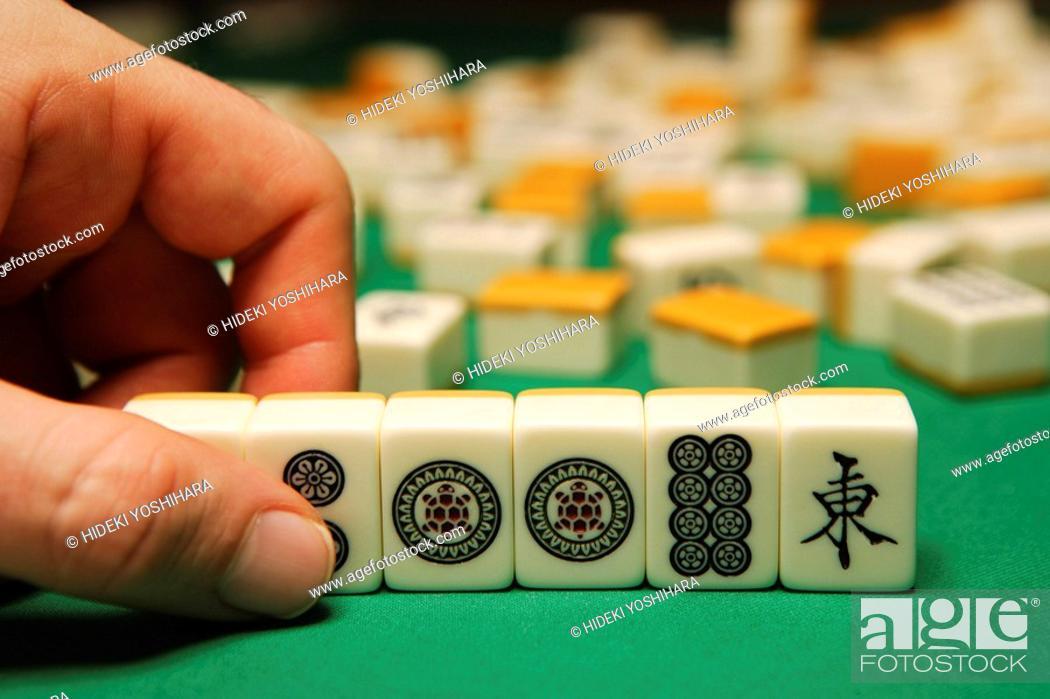 Stock Photo: Playing mahjong.