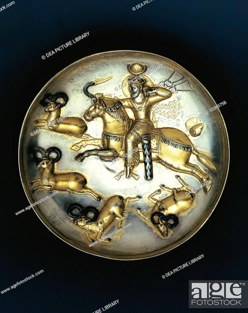 Stock Photo: Sassanid civilization, 5th century. Embossed silver plate depicting a hunting scene with the Sassanid King Firuz or Peroz I on horseback.
