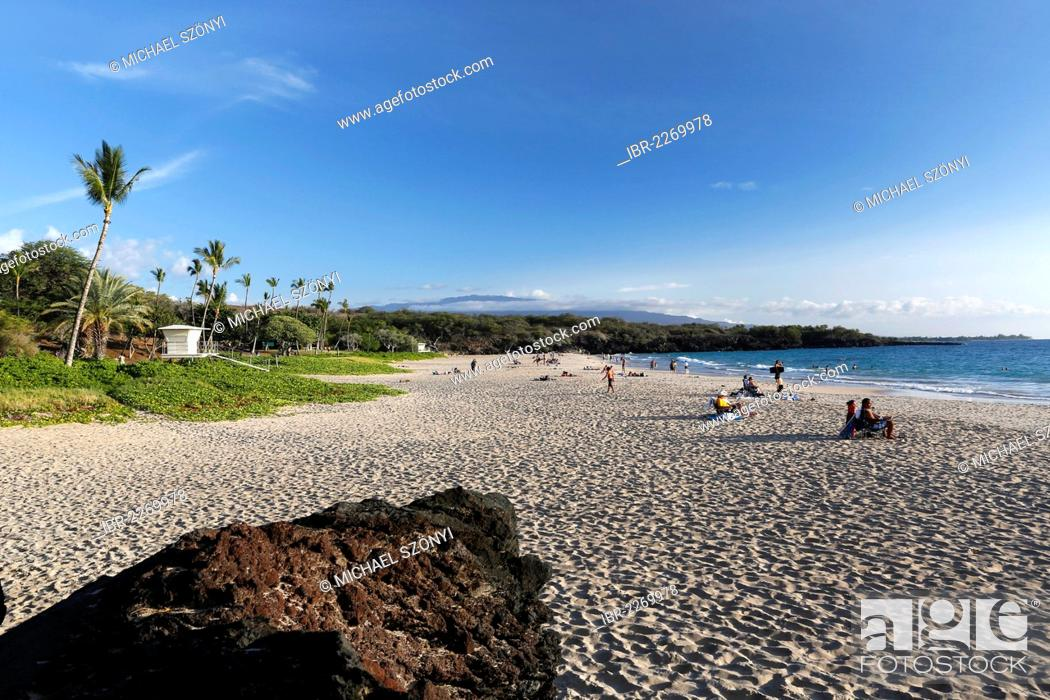 Hapuna Beach State Park With Golden Sand And Volcanic Rocks