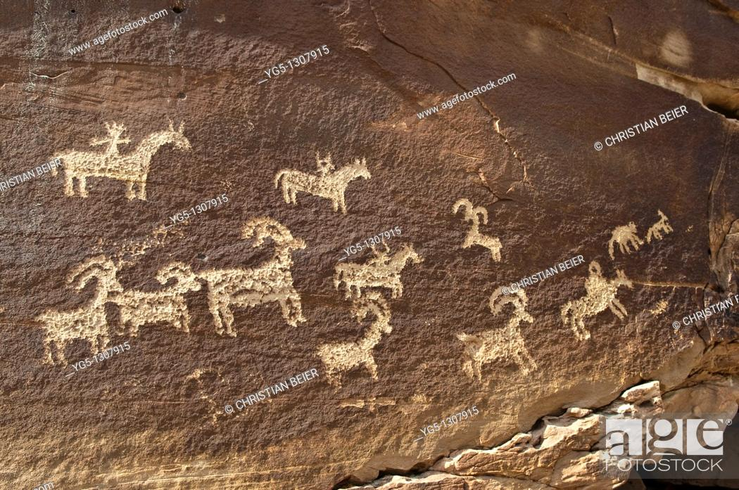 Stock Photo: Petroglyphs of the native Americans, about 1500 years old, near WOLF RANCH, Arches National Park, Utah, USA.
