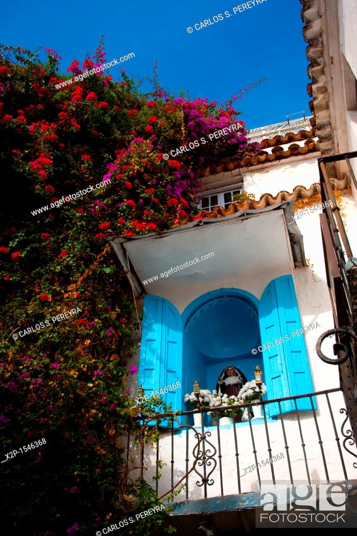 Stock Photo: Catholic detail in the downtown of Marbella, Costa del Sol, Andalucia, Spain.