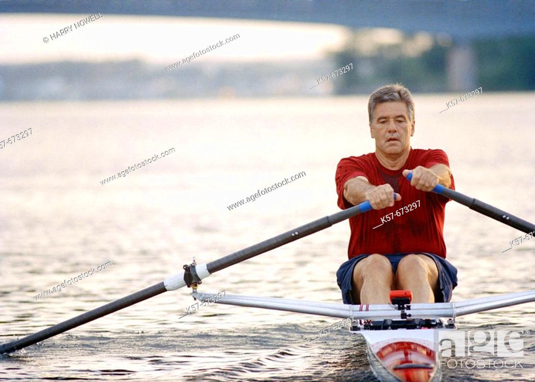 Stock Photo: Man rowing a single scull.