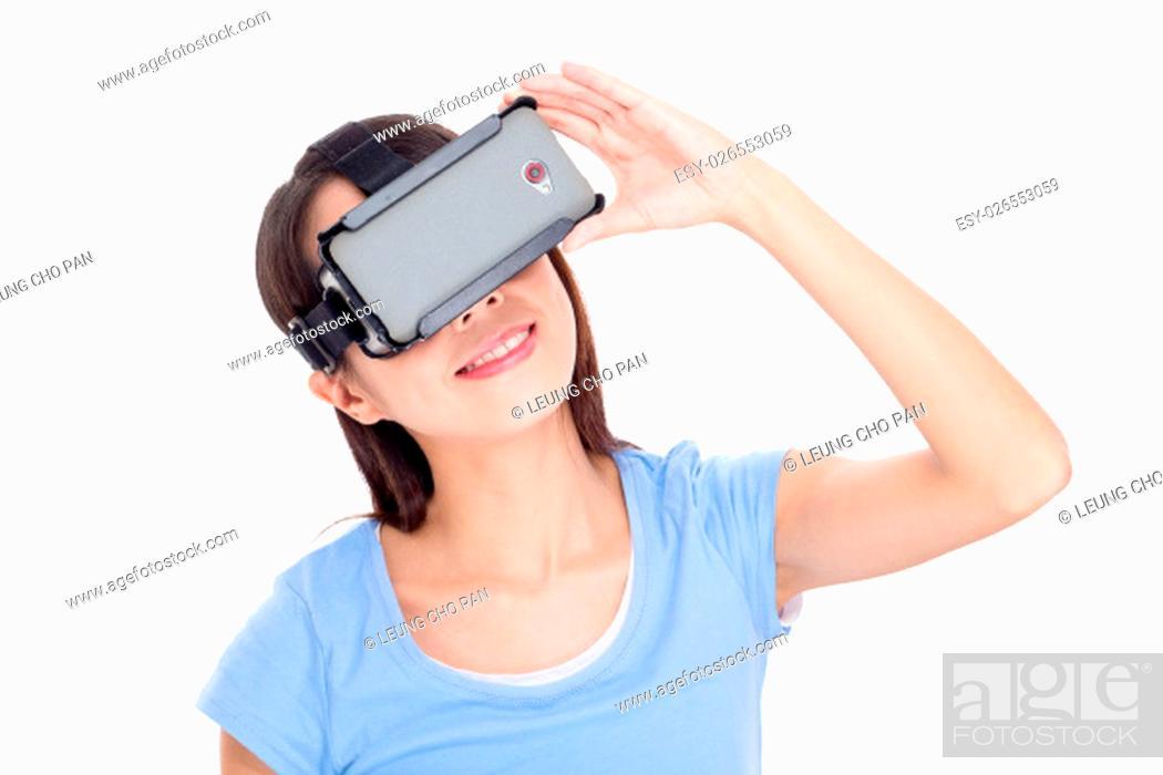 Stock Photo: Woman wearing virtual reality goggle.