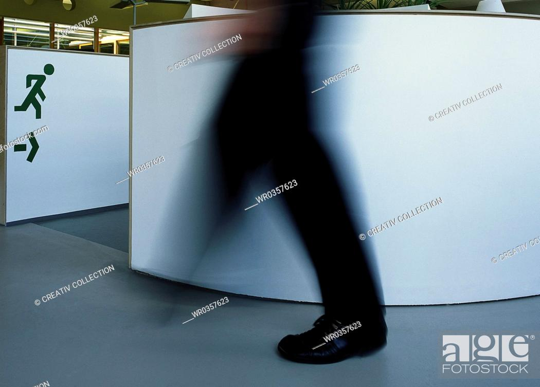 Stock Photo: vaguely outlined person walking towards the exit.