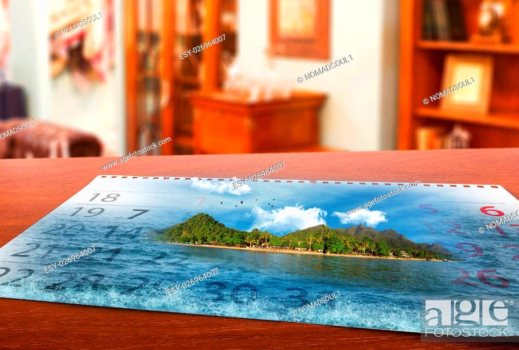 Stock Photo: Calendar with beautiful landscape lays on the table.