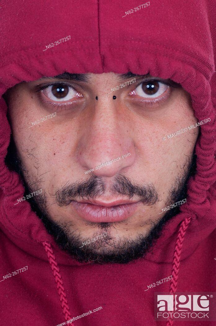 Stock Photo: Boy Middle East bearded, hooded, in a sweatshirt.