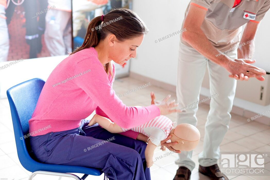 Stock Photo: First aid training courses given by the French Red Cross. This procedure is used in case of choking due to the obstruction of the larynx and consists in thrusts.