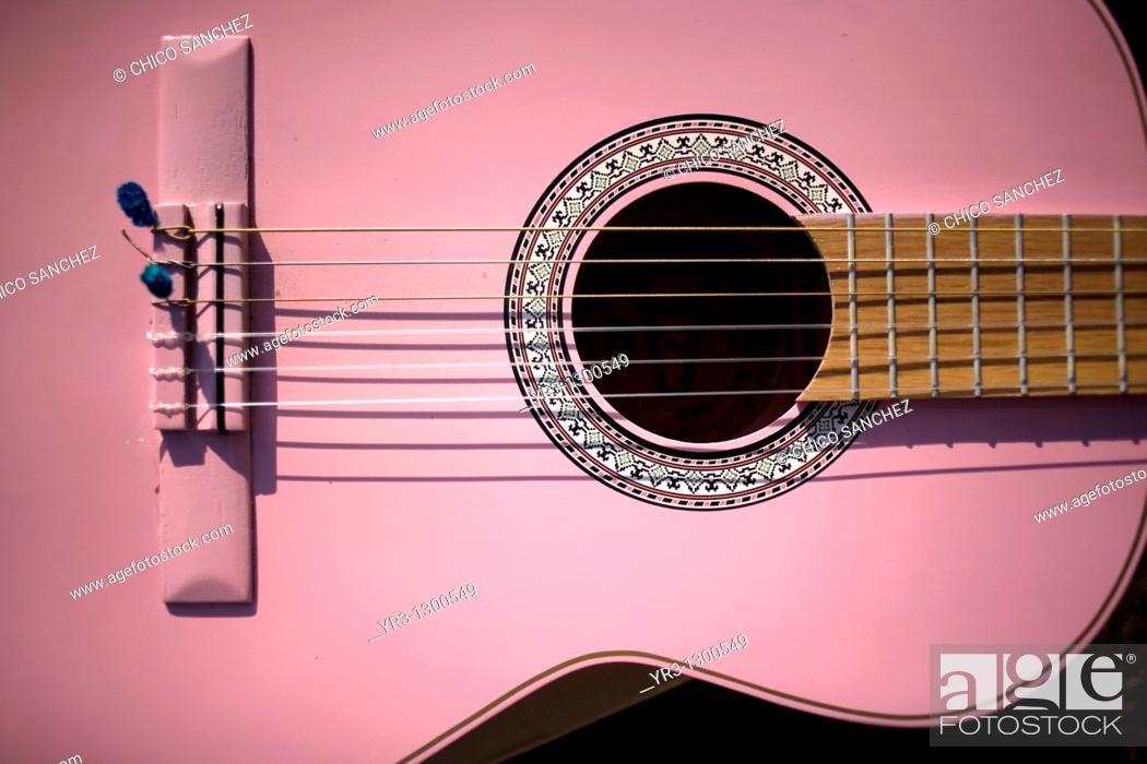 Stock Photo: Pink guitar, Mexico City, December 9, 2010.