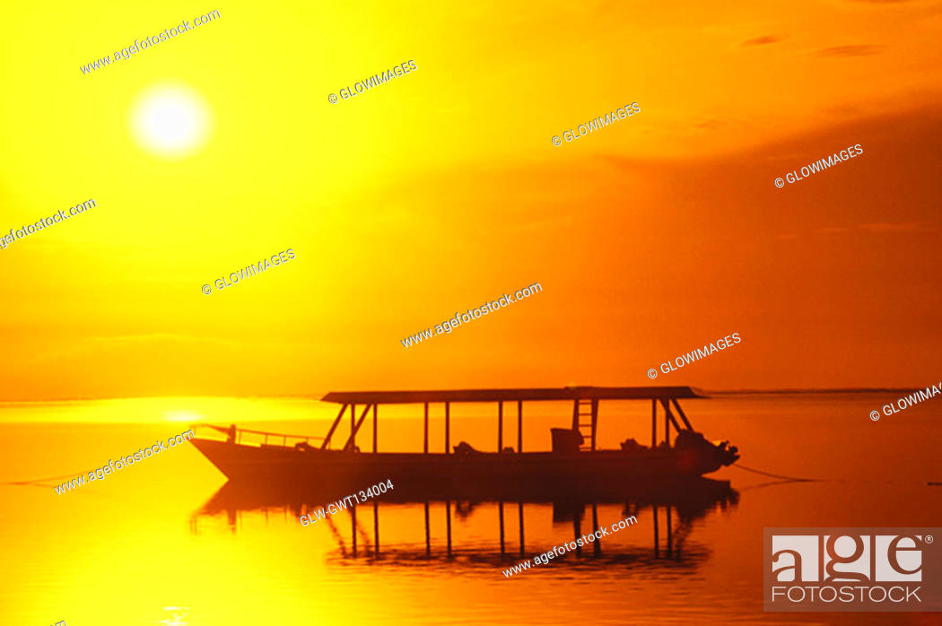 Stock Photo: Silhouette of a boat moored in the sea, Bali, Indonesia.