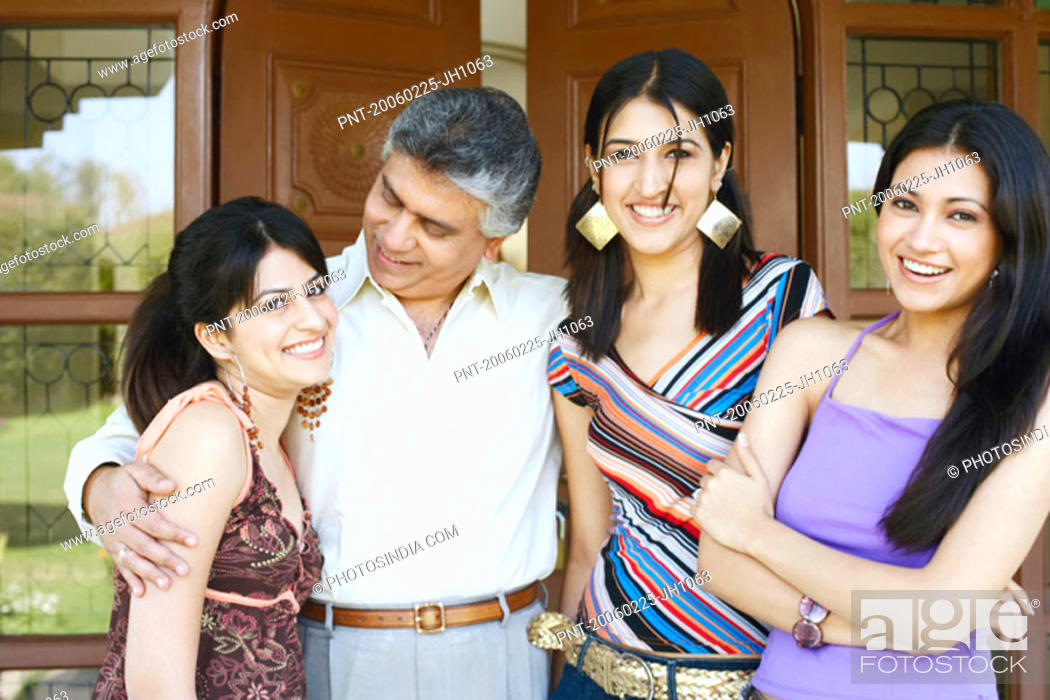 Stock Photo: Close-up of a father standing with his three daughters.
