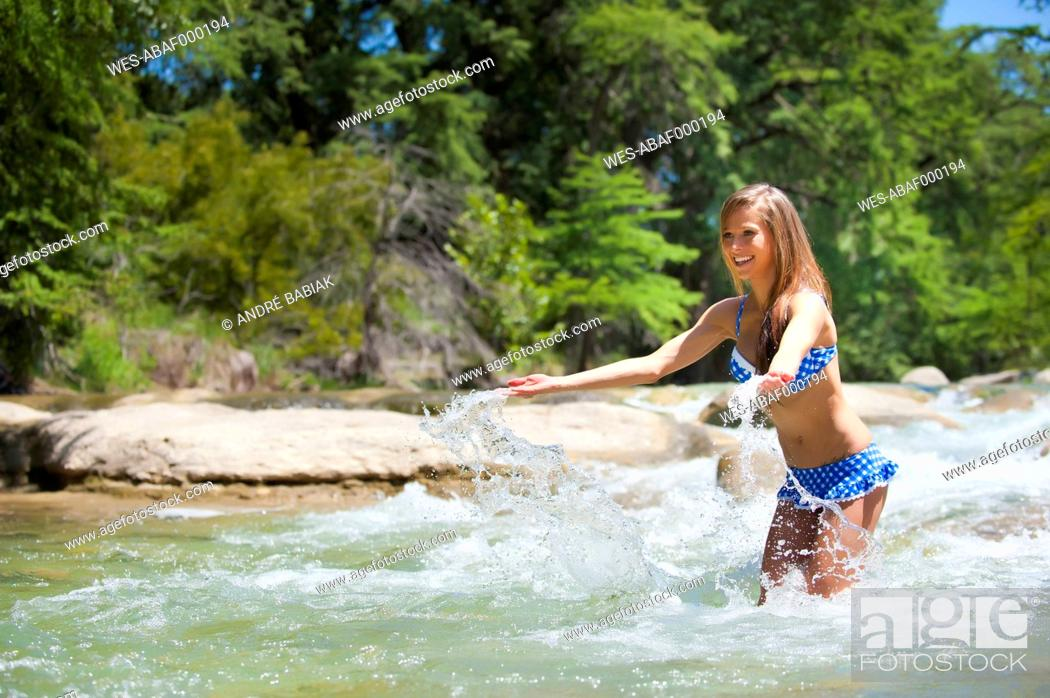 Stock Photo: USA, Texas, Young woman enjoying in Frio river.