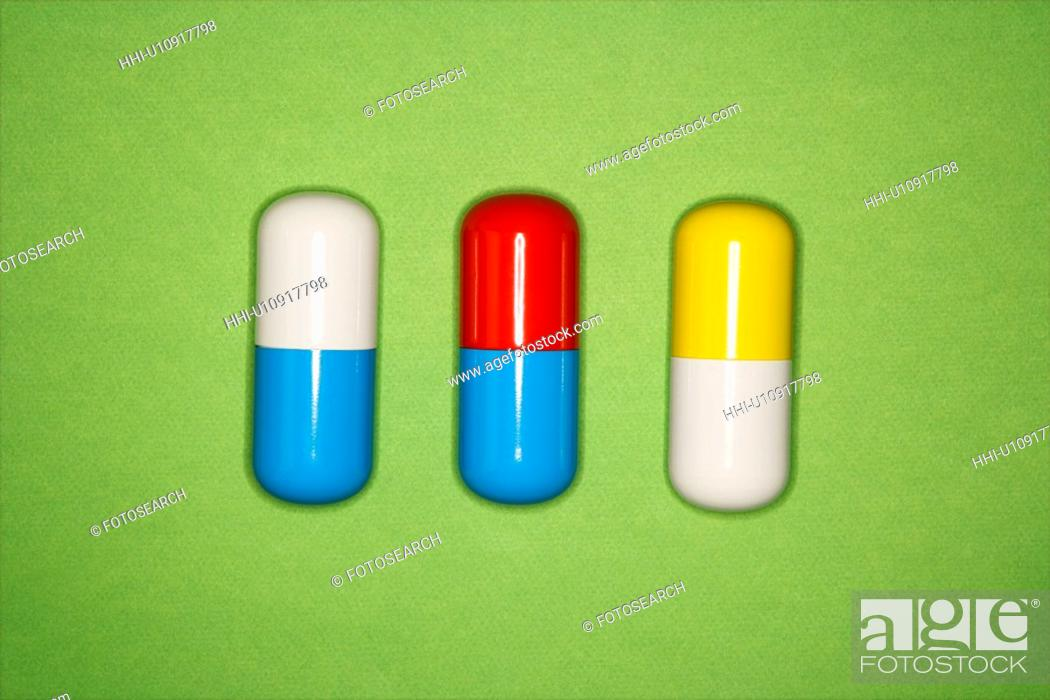Stock Photo: Medical pills on a green background.