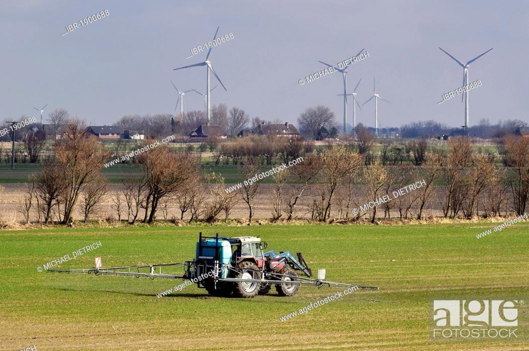 Intensive farming, farmer spraying pesticide, North Frisian