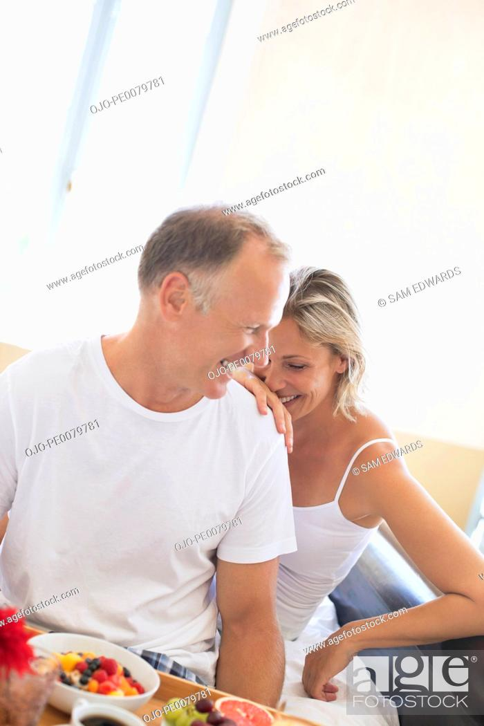 Stock Photo: Smiling couple eating breakfast.