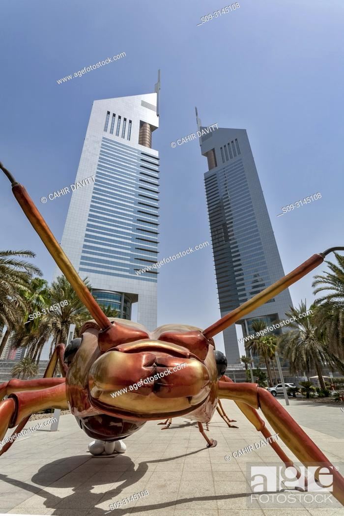 Stock Photo: The Jumeirah Emirate Towers complex, designed by NORR Architects, with an Ant public sculpture in the foreground, DIFC, Dubai, Dubayy, United Arab Emirates.